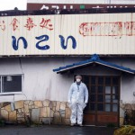 Fukushima cleanup: man in suit and mask