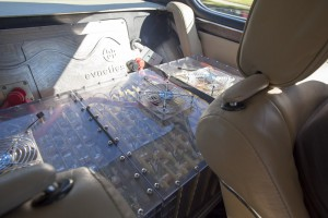 Two bulletproof glass cases filled with battery cells sit where the back seat used to be. There's another box in the trunk. Photo: Hugh Hamilton