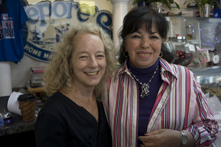 Morgan McNeish (l) a long time customer at Lepore's Chocolate Shop, where Lucille Burke recalls when Hoboken-native son Frank Sinatra would stop by for a favorite sweet. The shop is on high ground…it never flooded. But Lucille couldn't get out of her apartment building for days. (Photo: Donna Ferrato)
