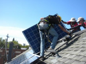 Solar workers installing panels on the Shawl Anderson Dance Center. (Photo: Andreas Karelas)